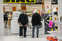 Customers search for appliance bargains at the soon to be closing Sears store in the New York borough of the Bronx on Sunday, October 26, 2014. Sears Holdings announced that it will close 77 Sears and Kmart stores prior to the Christmas holiday. This is in addition to previously announced closings and over 7000 jobs will be lost. (© Richard B. Levine)