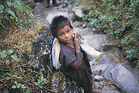 Kodari, in north central Nepal, is a cluster of scruffy wooden huts at the official border post between Nepal and China but it is surrounded by spectacular peaks. This small boy has been sent from his village several thousand feet above Kodari to do some basic shopping there and is making his way barefoot down the steep and rocky path.