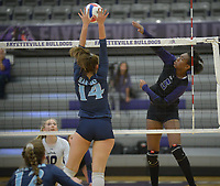 NWA Democrat-Gazette/ANDY SHUPE<br /> Fayetteville's Rosana Hicks (5) sends the ball past Har-Ber's Natalie Williams Wednesday, Sept. 13, 2017, during play in Bulldog Arena. Visit nwadg.com/photos to see more photographs from the match.