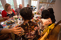 "SEATTLE, WA-APRIL 17, 2017: Hussein Saab, leads a prayer before dinner with Stefanie and Nason Fox, Anjana Agarwal, Patricia Rangel, and Greg and Charissa Pomrehn.<br /> <br /> Amanda Saab, along with her husband Hussein Saab, host a ""dinner with your Muslim neighbor"" at the home of Stefanie and Nason (cq) Fox in Seattle, WA on a return trip April 17th 2017. The couple now live in Detroit. (Photo by Meryl Schenker/For The Washington Post)"