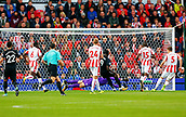 9th September 2017, bet365 Stadium, Stoke-on-Trent, England; EPL Premier League football, Stoke City versus Manchester United; Romelu Lukaku of Manchester United scores his teams second goal as he lifts the ball over Jack Butland of Stoke City  for 1-2
