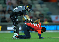 New Zealand's Colin Munro checks on England's Chris Jordan during the 4th Twenty20 International cricket match between NZ Black Caps and England at McLean Park in Napier, New Zealand on Friday, 8 November 2019. Photo: Dave Lintott / lintottphoto.co.nz