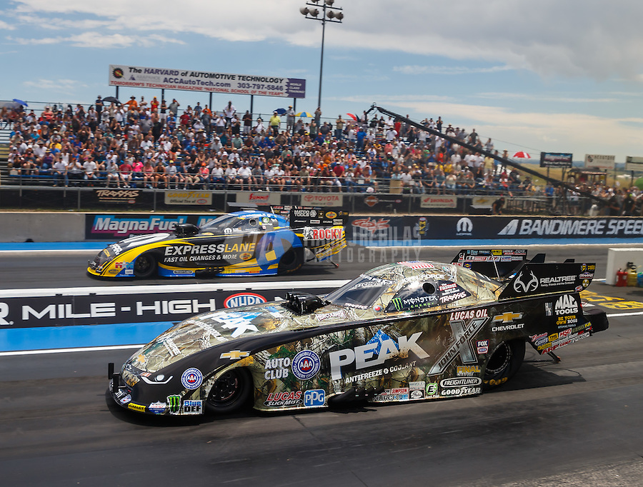 Jul 24, 2016; Morrison, CO, USA; NHRA funny car driver John Force (near) races alongside Matt Hagan during the Mile High Nationals at Bandimere Speedway. Mandatory Credit: Mark J. Rebilas-USA TODAY Sports