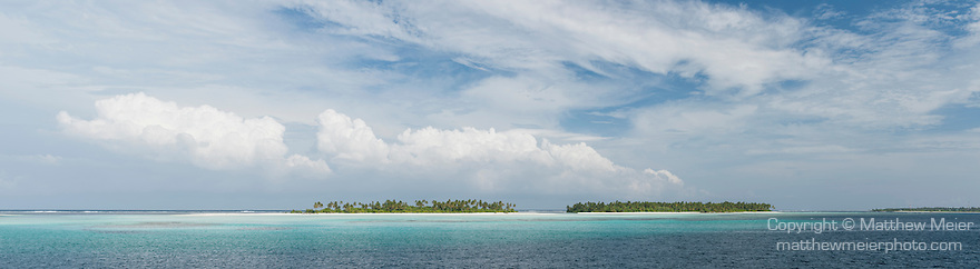 Maarehaa Island, Huvadhoo Atoll, Maldives; a panoramic view of a remote, deserted island in the Indian Ocean, with palm trees and white sand beaches, surrouded by a shallow coral reef