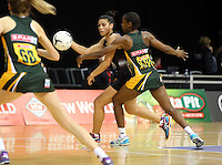 26.07.2015 Silver Ferns Grace Rasmussen and South Africa's Bongiwe Msomi in action during the Silver Fern v South Africa netball test match played at Claudelands Arena in Hamilton. Mandatory Photo Credit ©Michael Bradley.