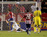 Columbus Crew goalkeeper William Hesmer (1) can't save the ball kicked in the goal by Chivas USA midfielder Blair Gavin (18). CD Chivas USA defeated the Columbus Crew 3-1 at Home Depot Center stadium in Carson, California on Saturday July 31, 2010.