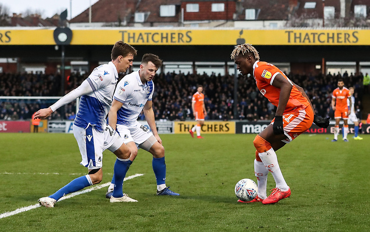 Blackpool's Armand Gnanduillet competing with Bristol Rovers' Joe Partington and Ollie Clarke<br /> <br /> Photographer Andrew Kearns/CameraSport<br /> <br /> The EFL Sky Bet League Two - Bristol Rovers v Blackpool - Saturday 2nd March 2019 - Memorial Stadium - Bristol<br /> <br /> World Copyright © 2019 CameraSport. All rights reserved. 43 Linden Ave. Countesthorpe. Leicester. England. LE8 5PG - Tel: +44 (0) 116 277 4147 - admin@camerasport.com - www.camerasport.com