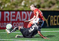Candace Chapman (5) slide tackles Caitlin Miskel (right). FC Gold Pride defeated the Washington Freedom 3-2 at Pioneer Stadium in Hayward, California on July 11th, 2010.