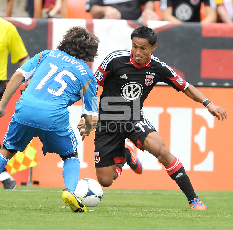 D.C. United midfielder Andy Najar (14) goes against Philadelphia Union defender Gabriel Farfan (15) D.C. United tied The Philadelphia Union 1-1 at RFK Stadium, Saturday August 19, 2012.