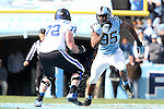 30 November 2013: UNC's Kareem Martin (95) tries to get around Duke's Perry Simmons (72). The University of North Carolina Tar Heels played the Duke University Blue Devils at Keenan Memorial Stadium in Chapel Hill, NC in a 2013 NCAA Division I Football game. Duke won the game 27-25.