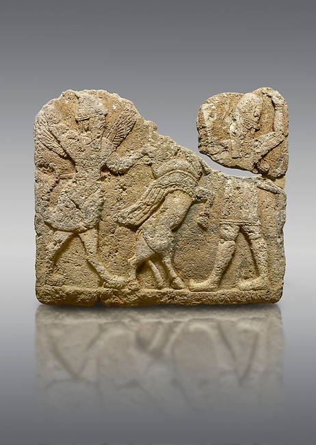 Hittite relief sculpted orthostat stone panel of Herald's Wall. Limestone, Karkamıs, (Kargamıs), Carchemish (Karkemish), 900-700 B.C. Anatolian Civilisations Museum, Ankara, Turkey.<br /> <br /> On the left is a winged mixed creature with a human head and body who has a scorpion tail and bird legs; on the right is a human-like god. The figures fight with a winged bull standing on its hind legs. The scorpion-man is known as Girtablull.