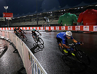PICTURE BY MARK GREEN/SWPIX.COM ATP  Tour of Abu Dhabi - Yas Island Stage, UAE, 26/02/17<br /> Riders brave the wet conditions and corner fast at the Yas Marina Circuit. Behind are some of the giant promotional jerseys.