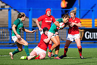 Sene Naoupu of Ireland is tackled by Bethan Lewis of Wales during the Women's Six Nations match between Wales and Ireland at Cardiff Arms Park, Cardiff, Wales, UK. Sunday 17 March 2019