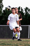 Palos Verdes, CA 01/22/13 - Joseph Barakat  (West Torrance #10) and Joseph Bruno (Peninsula #3) in action during the West vs Peninsula boys varsity soccer game at Peninsula High School.