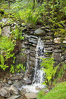 Flowing small waterfall at Eskdale in the Lake District, Cumbria, England