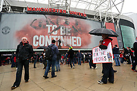 """Pictured: A man holding a """"Thank you for the memories"""" placard outside the ground before kick off. Sunday 12 May 2013<br /> Re: Barclay's Premier League, Manchester City FC v Swansea City FC at the Old Trafford Stadium, Manchester."""