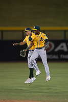 AZL Athletics outfielder Yhoelnys Gonzalez (35) and Danny Bautista (20) celebrate a victory after an Arizona League game against the AZL Cubs 1 at Sloan Park on June 28, 2018 in Mesa, Arizona. The AZL Athletics defeated the AZL Cubs 1 5-4. (Zachary Lucy/Four Seam Images)