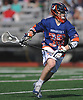 Michael Farrell #38 of Manhasset carries downfield during the 133rd Woodstick Classic against host Garden City High School on Saturday, April 28, 2018. Manhasset won by a score of 7-4.