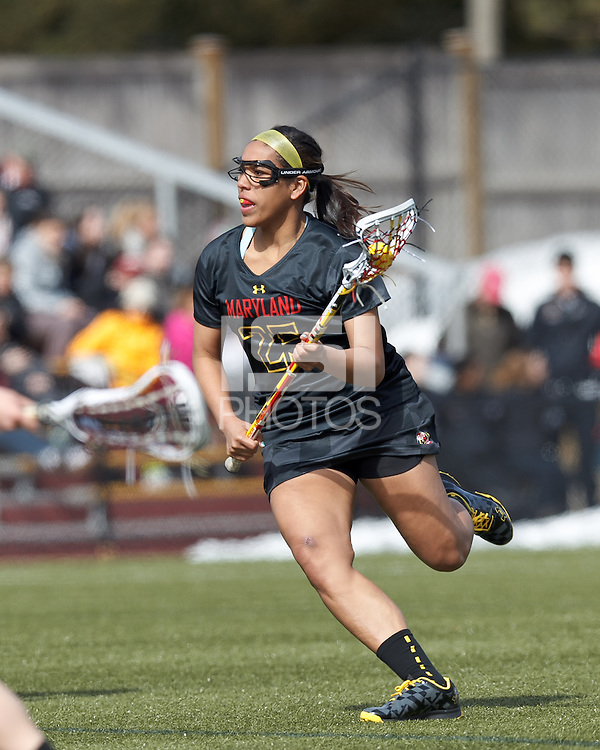University of Maryland midfielder/defender Jen Mendez (25) brings the ball forward. .University of Maryland (black) defeated Boston College (white), 13-5, on the Newton Campus Lacrosse Field at Boston College, on March 16, 2013.