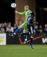 Osvaldo Alonso of Sounders battles for the ball in the air against Earthquake defender during the game at Buck Shaw Stadium in Santa Clara, California on April 2nd, 2011.   San Jose Earthquakes and Seattle Sounders are tied 2-2.