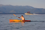 kayaker and boat at D.L. Bliss State Park, Lake Tahoe