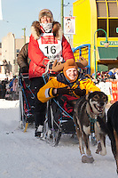 Musher Jodi Bailey and Iditarider  Dan Faltyn.leave the 2011 Iditarod ceremonial start line in downtown Anchorage, Alaska
