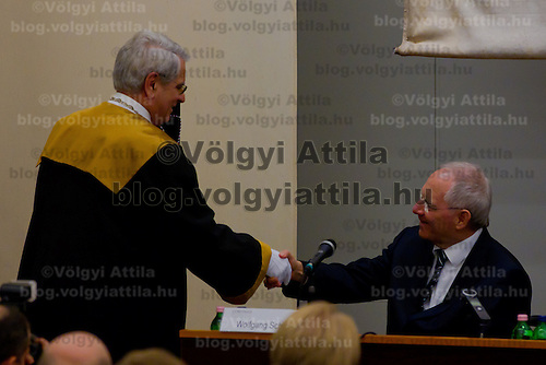 Wolfgang Schaeuble (R) Finance Minister for Germany receives the title of Honorary Doctor of Corvinus University from Rector Tamas Meszaros (L) before the Europe on Crossroads conference organized by Corvinus University in Budapest, Hungary on December 05, 2011. ATTILA VOLGYI