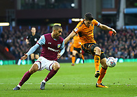 Danny Batth of Wolverhampton Wanderers wins the challenge for the ball against Lewis Grabban of Aston Villa<br /> <br /> Photographer Leila Coker/CameraSport<br /> <br /> The EFL Sky Bet Championship - Aston Villa v Wolverhampton Wanderers - Saturday 10th March 2018 - Villa Park - Birmingham<br /> <br /> World Copyright &copy; 2018 CameraSport. All rights reserved. 43 Linden Ave. Countesthorpe. Leicester. England. LE8 5PG - Tel: +44 (0) 116 277 4147 - admin@camerasport.com - www.camerasport.com