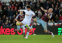 Pictured: Nelson Oliveira, the new signing for Swansea is fouled by James Collins of West Ham Saturday 10 January 2015<br />