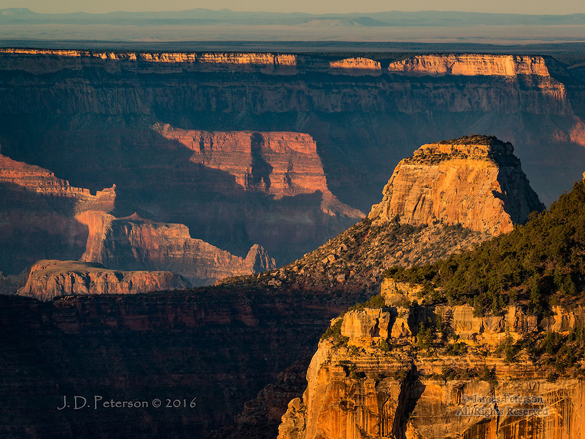 North Rim Sunrise ©2016 James D Peterson.  During summer months, morning light sculpts the ridges and depths of the canyon.
