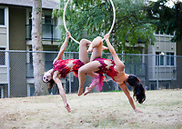 Sanca Women Acrobatics Suspended on Ring, Arts-A-Glow Festival, Dottie Harper Park, Burien, WA, USA.