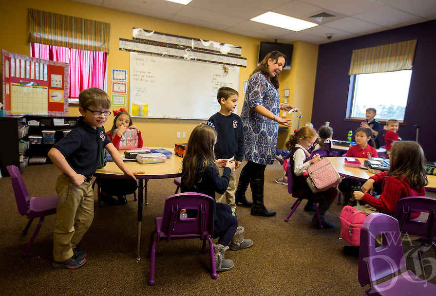 NWA Democrat-Gazette/JASON IVESTER<br /> Jenne Rodgers, first-grade teacher, gets her students ready for lunch on Thursday, Jan. 7, 2016, at Providence Academy in Rogers.