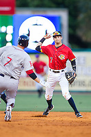 Charleston RiverDogs shortstop Tyler Wade (7) turns a double play as Stephen Drew (7) of the Greenville Drive slides into second base at Joseph P. Riley, Jr. Park on May 26, 2014 in Charleston, South Carolina.  The Drive defeated the RiverDogs 11-3.  (Brian Westerholt/Four Seam Images)