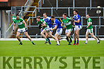 Donal Lyne Legion is tracked by Giles O'Grady and David Moran KOR during their SFC clash in Fitzgerald Stadium on Sunday