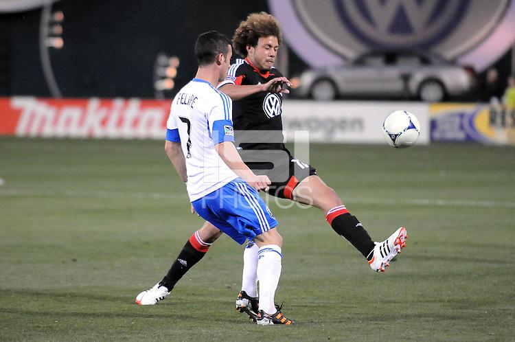 D.C. United midfielder Nick DeLeon (18) goes against Montreal Impact midfielder Felipe Martins (7)  D.C. United tied The Montreal Impact 1-1, at RFK Stadium, Wednesday April 18 , 2012.