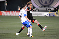 D.C. United midfielder Nick DeLeon (18) goes against Montreal Impact midfielder Felipe Martins (7)  D.C. United tied The Montreal Impact 1-1, at RFK Stadium, Wednesday April 18 , 2012.