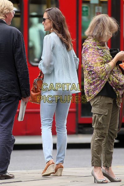 Pippa MIddleton spotted Chelsea, London, England..September 2nd, 2011.full length blue top sheer sunglasses shades jeans denim back behind rear wedges shoes .CAP/HIL.©John Hillcoat/Capital Pictures .