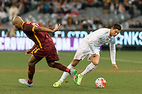 Melbourne, 18 July 2015 - Maicon of AS Roma and Cristiano Ronaldo of Real Madrid compete for the ball in game one of the International Champions Cup match at the Melbourne Cricket Ground, Australia. Roma def Real Madrid 7-6 Penalties. Photo Sydney Low/AsteriskImages.com
