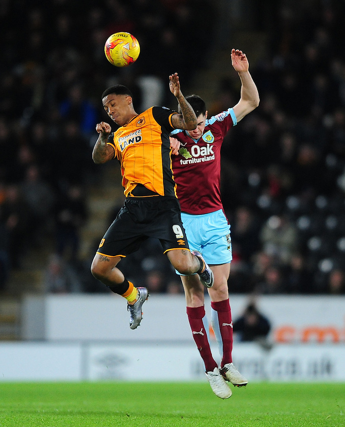 Burnley's Michael Keane vies for possession with Hull City's Abel Hernandez<br /> <br /> Photographer Chris Vaughan/CameraSport<br /> <br /> Football - The Football League Sky Bet Championship - Hull City v Burnley - Saturday 26th December 2015 - Kingston Communications Stadium - Hull<br /> <br /> &copy; CameraSport - 43 Linden Ave. Countesthorpe. Leicester. England. LE8 5PG - Tel: +44 (0) 116 277 4147 - admin@camerasport.com - www.camerasport.com
