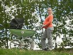 Pregnant woman pushing pram