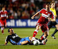 San Jose midfielder Ramiro Corrales (12) slide tackles Chicago Fire forward Chad Barrett (19).  The Chicago Fire tied the San Jose Earthquakes 0-0 at Toyota Park in Bridgeview, IL on June 28, 2008.