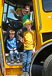 """Torrington, CT 051819MK08 Brothers Carter, Owen, Miles and Oliver Wade pose from heavy equipment at the O&G Industries' annual Touch a Truck Family Fun Event at their maintenance facility on Saturday Morning.  Seth Duke, marketing director, said """" With the weather so nice today we will receive over two-thousand attendees and the suggested donations will be donated to Kids Play to help with their continued development.""""  O&G's Jim Zambero, vice president of equipment purchase and maintenance, said that sixty volunteers and twentyfive local vendors helped host the event while members of the Operational Engineer's Union Local #478 directed traffic and managed parking . Michael Kabelka / Republican-American"""