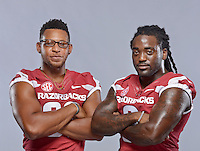 NWA Democrat-Gazette/BEN GOFF &bull; @NWABENGOFF<br /> Jonathan Williams (left) and fellow running back Alex Collins pose for a photos on Sunday Aug. 9, 2015 during Arkansas football media day at the Fred W. Smith Football Center in Fayetteville.