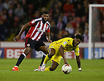 Ethan Ebanks-Landell of Sheffield Utd tussles with Ellis Harrison of Bristol Rovers during the League One match at Bramall Lane Stadium, Sheffield. Picture date: September 27th, 2016. Pic Simon Bellis/Sportimage