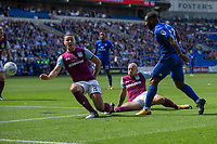 Junior Hoilett of Cardiff City shoots under pressure from James Chester and Alan Hutton of Aston Villa during the Sky Bet Championship match between Cardiff City and Aston Villa at the Cardiff City Stadium, Cardiff, Wales on 12 August 2017. Photo by Mark  Hawkins / PRiME Media Images.