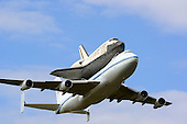 Space Shuttle Discovery flies over Washington Dulles International Airport in Virginia during its final flight from the Kennedy Space Center in Florida on Tuesday, April 17, 2012.  Discovery will be on permanent display at the  Smithsonian Institution's Steven F. Udvar-Hazy Center in Chantilly, Virginia..Credit: Ron Sachs / CNP.(RESTRICTION: NO New York or New Jersey Newspapers or newspapers within a 75 mile radius of New York City)