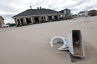 Damage caused by Hurricane Sandy, Breezy Point, Queens, NY, five days after the hurricane hit.  A toilet bowl lies on the beach near Kennedy's Restaurant, which sustained extensive damage..Breezy Point is a beachfront neighborhood located on the western end of the Rockaway peninsula, between Rockaway Inlet and Jamaica Bay on the landward side, and the Atlantic Ocean.