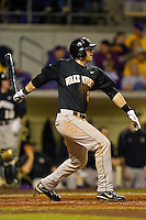 James Harris #22 of the Wake Forest Demon Deacons follows through on his swing against the LSU Tigers at Alex Box Stadium on February 18, 2011 in Baton Rouge, Louisiana.  The Tigers defeated the Demon Deacons 15-4.  Photo by Brian Westerholt / Four Seam Images