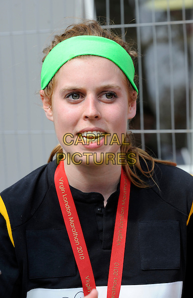 HRH PRINCESS BEATRICE.At the Virgin London Marathon 2010 Finish Line, London, England.April 25th, 2010.headshot portrait royal royalty green headband black funny face mouth open.CAP/DH.©David Hitchens/Capital Pictures.