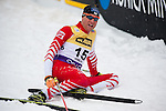 HOLMENKOLLEN, OSLO, NORWAY - March 16: Bernhard Gruber of Austria (AUT) exhausted in the snow after the cross country 15 km (2 x 7.5 km) competition at the FIS Nordic Combined World Cup on March 16, 2013 in Oslo, Norway. (Photo by Dirk Markgraf)